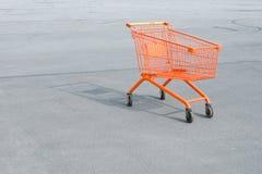 Basket. Orange basket on a background of asphalt stock photos