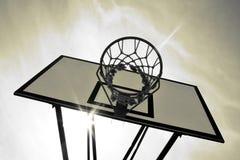 Basket. Sun beam behind basket. B&w imaged, toned Stock Image