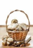 Basket of agaricus mushroom on wooden table Stock Image