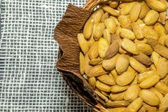 Basket with almonds Royalty Free Stock Image