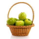 Basket with apples. Basket with fresh green apples isolated over white royalty free stock photos