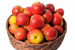 Basket of apples. Straw basket of apples isolated on white background Stock Image