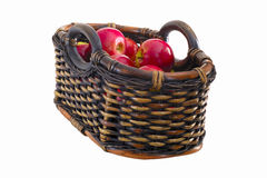 Basket of apples. A basket full of red apples isolated on white Stock Photo