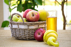 A basket of apples and apple juice Stock Photography