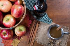 Basket of apples with cup and bottle of apple cider top view Stock Images