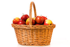A basket apples. Fresh juicy apples in the basket Stock Photos