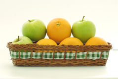 A basket apples and oranges Royalty Free Stock Image