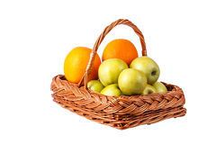 Basket with apples and oranges. On a white background Royalty Free Stock Image