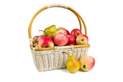 Basket with apples. And pears on a white background royalty free stock photos