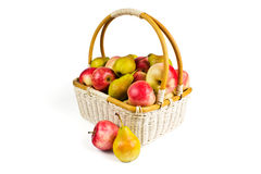 Basket with apples. And pears on a white background stock images