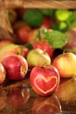 Basket of apples on a wet table Royalty Free Stock Photography