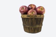 Basket of apples,. A basket of apples on a white back ground stock photo