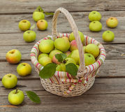 Basket with apples on a wooden background Royalty Free Stock Photos