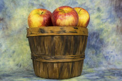 Basket of apples. A wooden basket fill with apples Royalty Free Stock Photo