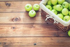 Basket of apples on a wooden table. Free space for text. Basket of apples on a wooden table royalty free stock photo