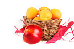 Basket apricot and nectarine isolated on a white. Basket of fresh apricot and nectarine isolated on a white Royalty Free Stock Images