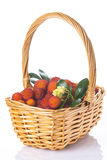 Basket with arbutus unedo fruits over white Stock Images