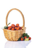 Basket with arbutus unedo fruits over white Royalty Free Stock Image