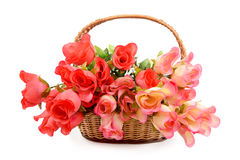 Basket with  artificial flowers Stock Photo