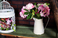Basket with artificial flowers, beautiful Provence Stock Photo