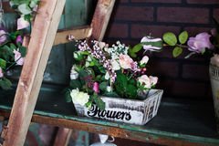 Basket with artificial flowers, beautiful Provence Stock Image
