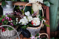 Basket with artificial flowers, beautiful Provence Royalty Free Stock Photos