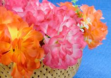 Basket of artificial flowers Royalty Free Stock Image