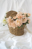 Basket with artificial flowers Royalty Free Stock Image