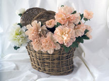 Basket with artificial flowers Royalty Free Stock Photography