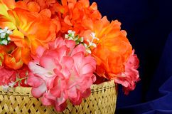 Basket of artificial peonies roses Royalty Free Stock Photography