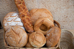 Basket of assorted bread rolls and bagels Royalty Free Stock Photography