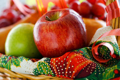 Basket of Assorted Fruits. For Christmas. Fresh, crisp and tangy green apples; crunchy and sweet red apples, crisp and sweet Bosc pears, and ripe and sweet red stock photography