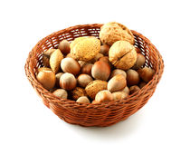 Basket of assorted nuts. On white background Stock Photo