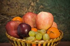 Basket with autumn fruits. A basket with seasonal autumn fruits Stock Image