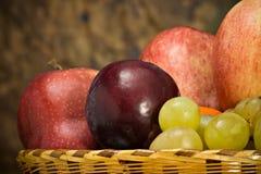 Basket with autumn fruits. A basket with seasonal autumn fruits Royalty Free Stock Photo