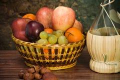 Basket with autumn fruits. A basket with seasonal autumn fruits Stock Photos