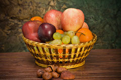 Basket with autumn fruits. A basket with seasonal autumn fruits Stock Photography