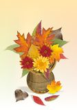 Basket with autumn leaves and flowers Royalty Free Stock Image