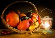 Basket with autumn vegetables,pumpkin,paprika,aubergine,tomato Stock Image