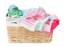 Basket of baby clothing isolated. Royalty Free Stock Images