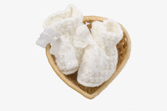 Basket with baby's bootee. Wicker basket heart-shaped with baby's bootee Royalty Free Stock Images