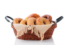 Basket of Bagels. A basket of fresh baked bagels. Horizontal format isolated on white with reflection Royalty Free Stock Photos
