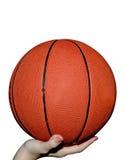 Basket-ball à disposition Image stock