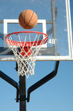Basket Ball. Is going into the hoop after being shot Royalty Free Stock Photography