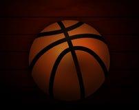 Basket-ball au fond des planches en bois Images stock