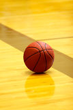 Basket ball on court Royalty Free Stock Photo