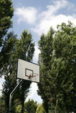 Basket ball court. A basket ball hoop on an out door court Royalty Free Stock Photos