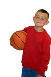 Basket-ball de fixation de garçon Photos stock