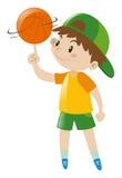 Basket-ball de rotation de garçon sur le doigt Images stock