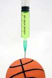 Basket ball doping. Needle into a basketball Royalty Free Stock Images